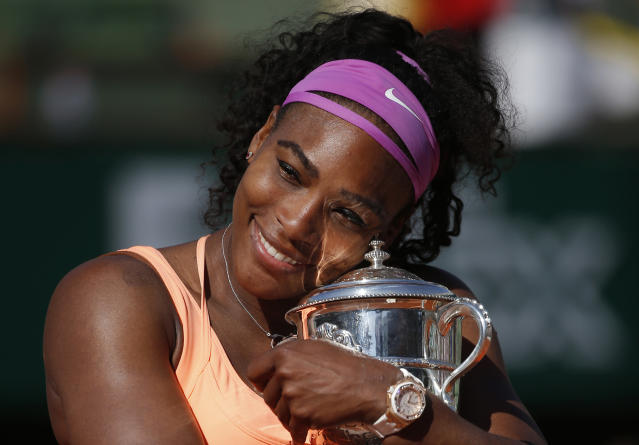 FILE - In this June 6, 2015, file photo, Serena Williams holds the trophy after winning the final of the French Open tennis tournament against Lucie Safarova of the Czech Republic, at the Roland Garros stadium in Paris, France. Welcome back to Paris, Serena Williams. The tennis world cant wait to find out exactly how that bothersome left knee is holding up. (AP Photo/Michel Euler, File)