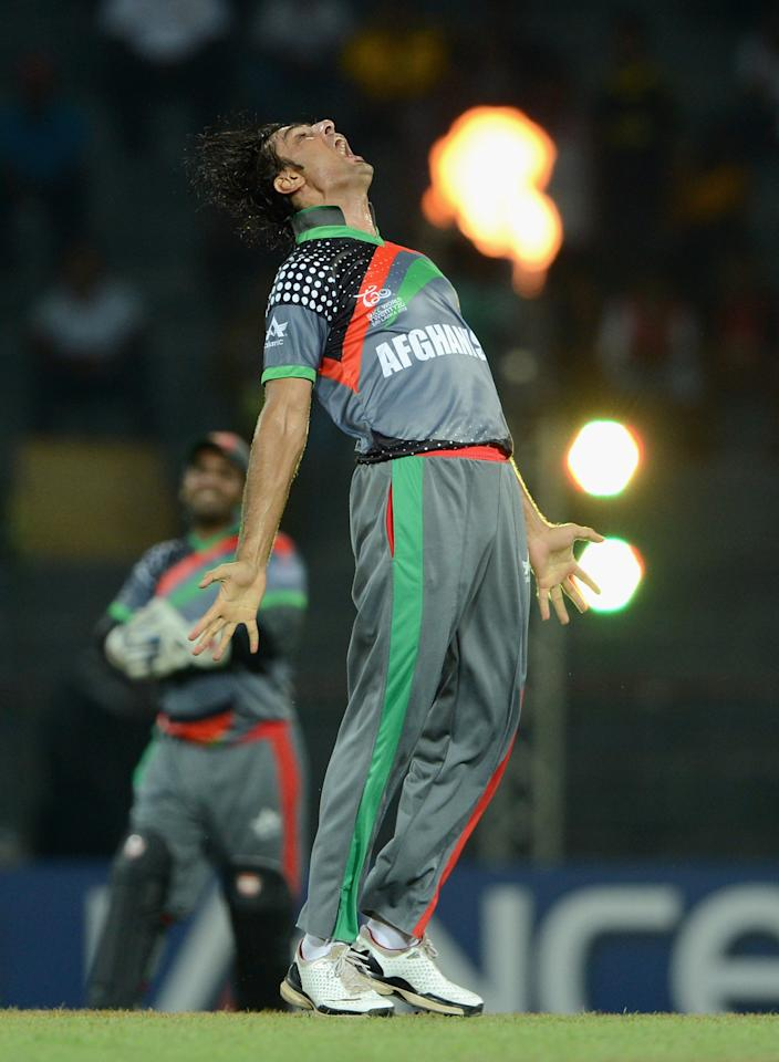 COLOMBO, SRI LANKA - SEPTEMBER 19:  Shapoor Zadran of Afghanistan celebrates dismissing Virender Sehwag of India during the  ICC World Twenty20 2012: Group A match between India and Afghanistan at R. Premadasa Stadium on September 19, 2012 in Colombo, Sri Lanka.  (Photo by Gareth Copley/Getty Images,)