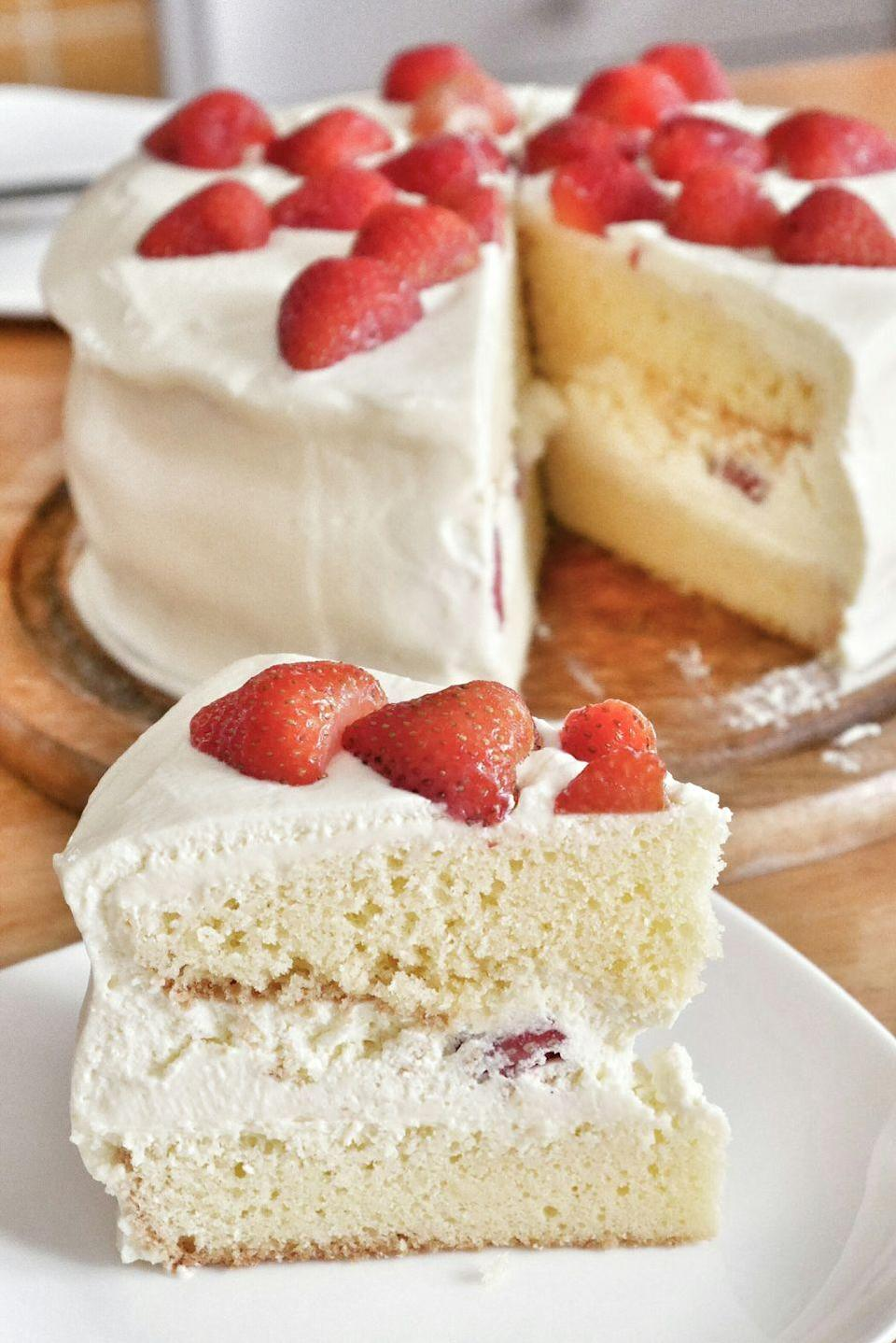 """<p>This cake is a cross between strawberry shortcake (a summer classic) and strawberry cake. Just imagine some bright, colorful sparklers sticking out of the white frosting — perfect for just before the fireworks.</p><p><em><strong>Get the recipe at <a href=""""https://www.thepioneerwoman.com/food-cooking/recipes/a11487/strawberry-shortcakecake/"""" rel=""""nofollow noopener"""" target=""""_blank"""" data-ylk=""""slk:The Pioneer Woman."""" class=""""link rapid-noclick-resp"""">The Pioneer Woman.</a></strong></em></p>"""