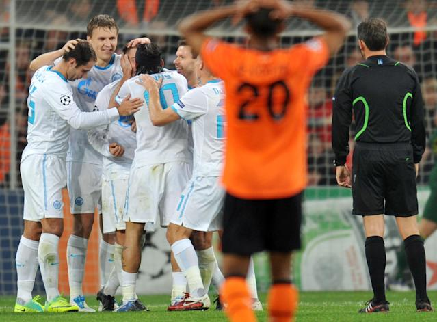 Players of FC Zenit St Petersburg react after they scored against FC Shakhtar during UEFA Champions League, Group G football match in Donetsk on October 19, 2011 The match ended 2:2. AFP PHOTO/ SERGEI SUPINSKY (Photo credit should read SERGEI SUPINSKY/AFP/Getty Images)