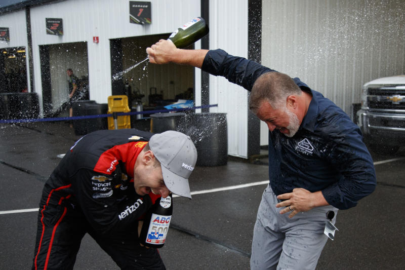 Will Power, left, celebrates with Pocono Raceway's Nick Igdalsky after winning an IndyCar Series auto race at Pocono, Sunday, Aug. 18, 2019, in Long Pond, Pa. (AP Photo/Matt Slocum)