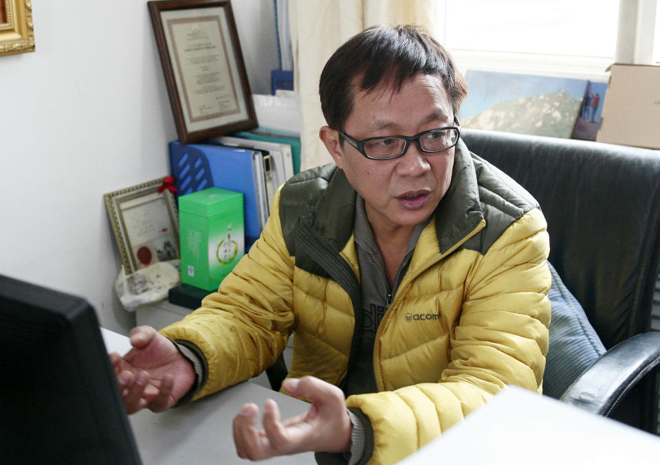 In this Nov. 22, 2012 photo, Meng Lin, coordinator of China Alliance of People Living with HIV/AIDS, talks during an interview in his office in Beijing, China. In China, hospitals routinely reject people with HIV for surgery out of fear of exposure to the virus or harm to their reputations. After years of denying AIDS was a problem in China, the country has significantly improved care for patients, but the lingering stigma sets back those advances. (AP Photo/Gillian Wong)