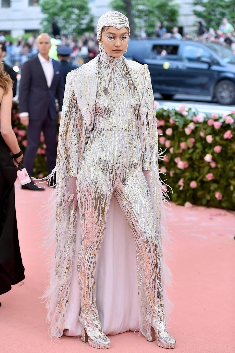 In head-to-toe Michael Kors, Gigi took the Camp theme of the Met Gala and ran with it, transforming herself into a literal bird of paradise-meets-Liberace mash-up. From her sequined skullcap to her feathered lashes, we give her a perfect 10 for nailing the theme.