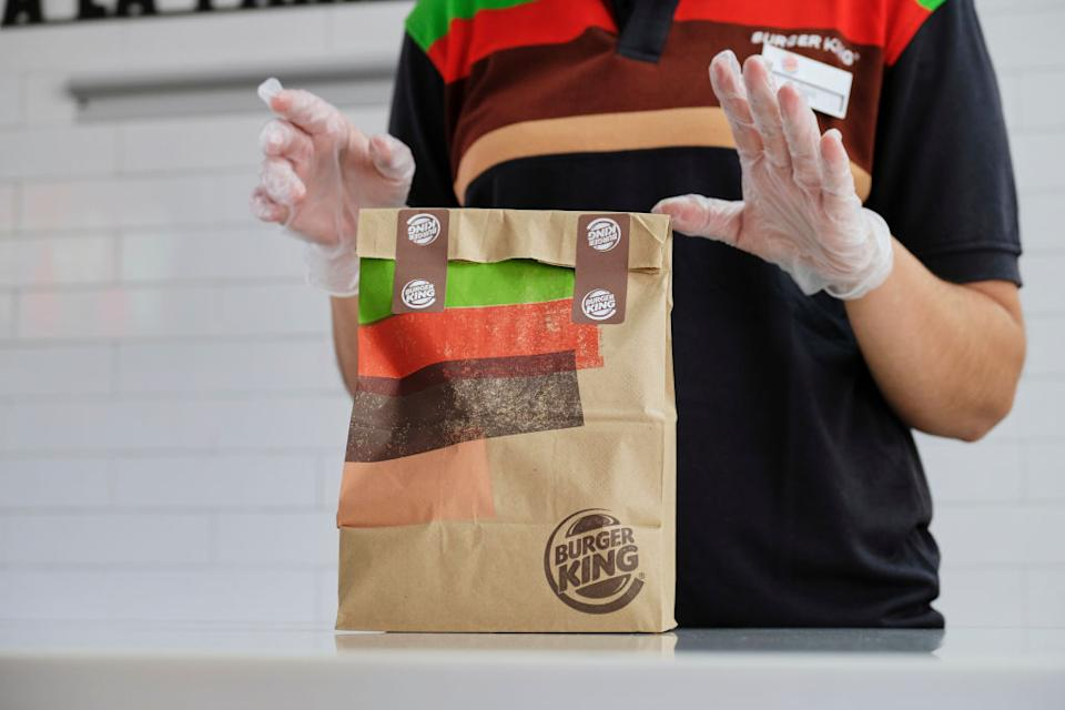 A Burger King employee packages up an order.