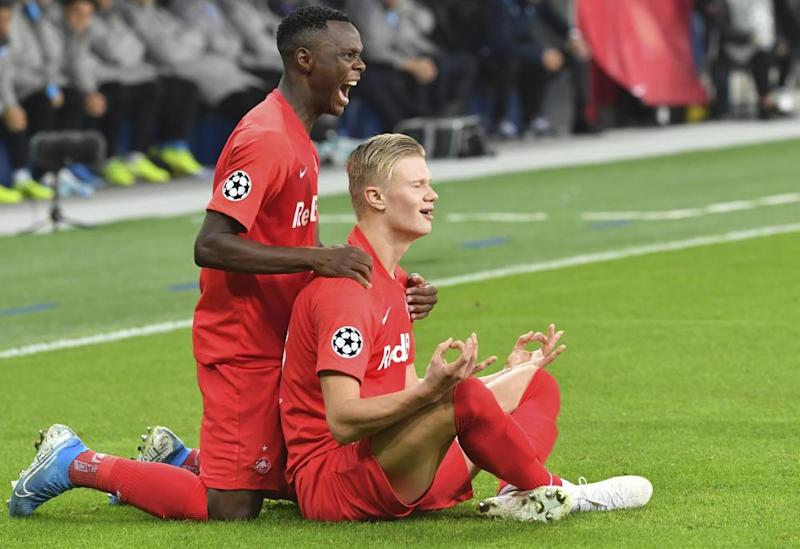 Erling Braut Haaland, right, celebrates with his now former teammate Patson Daka during RB Salzburg's Champions League campaign this season.