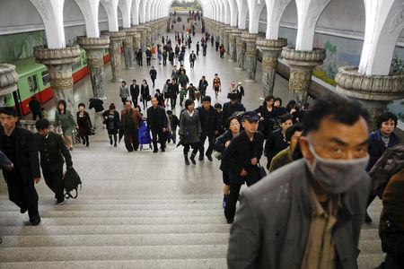 FILE PHOTO: People leave a subway station visited by foreign reporters, in central Pyongyang