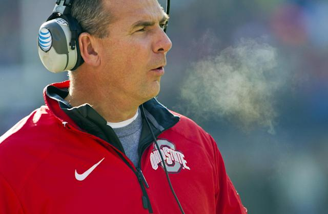 Ohio State head coach Urban Meyer reacts on the sideline in the first quarter of an NCAA college football game against Michigan in Ann Arbor, Mich., Saturday, Nov. 30, 2013. (AP Photo/Tony Ding)
