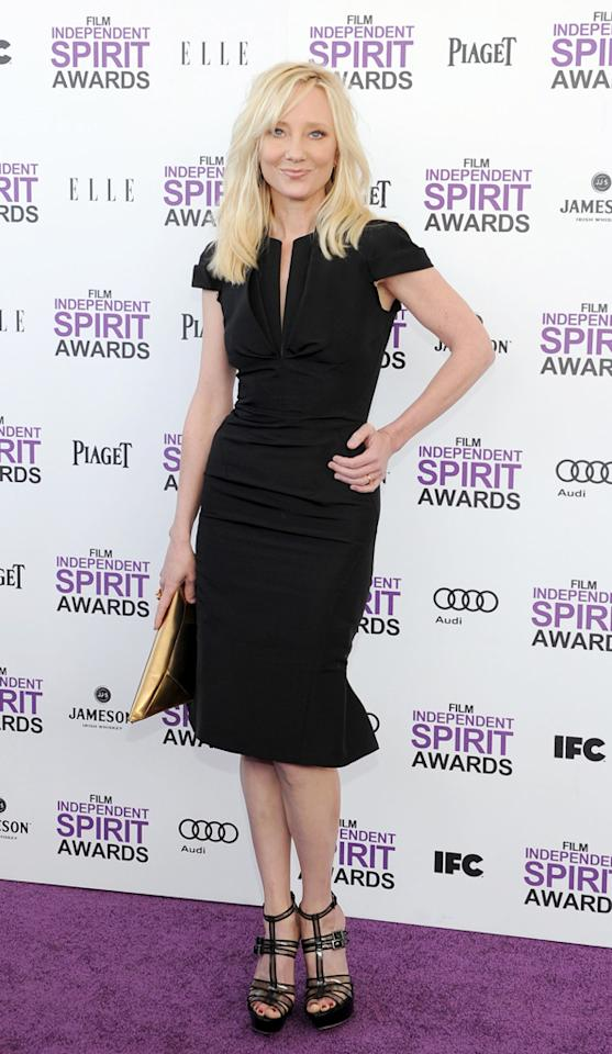 Anne Heche went back to basic black. She paired a simple sheath with strappy heels and added a flash of gold courtesy of her clutch.