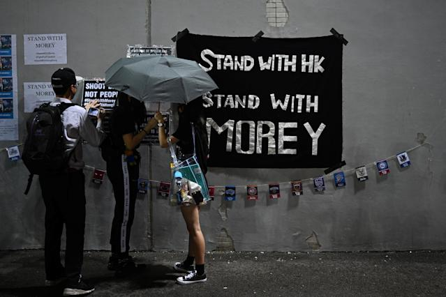 Protesters display posters in Hong Kong (Credit: Getty Images)