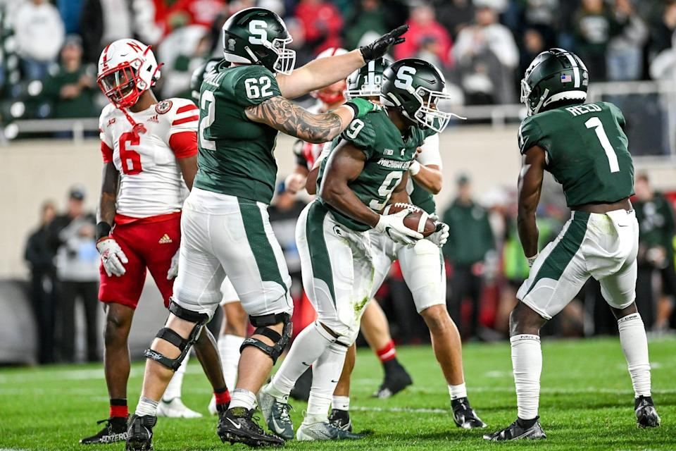 Michigan State's Kenneth Walker III, right, celebrates after a run against Nebraska during overtime on Saturday, Sept. 25, 2021, at Spartan Stadium in East Lansing.