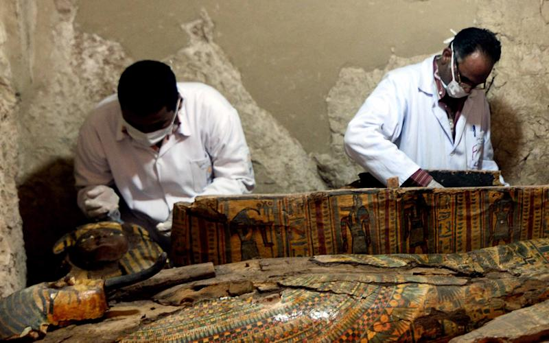 Egyptian archaeologists document the content of a recently discovered tomb at the Draa Abul Nagaa necropolis in Luxor's West Bank, 650km south of Cairo, Egypt, 18 April 2017 - Credit: AHMED TARANH/EPA