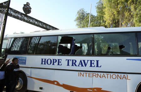A damaged bus is seen after an attack by gunmen on Tunisia's national museum in Tunis March 18, 2015. REUTERS/Zoubeir Souissi