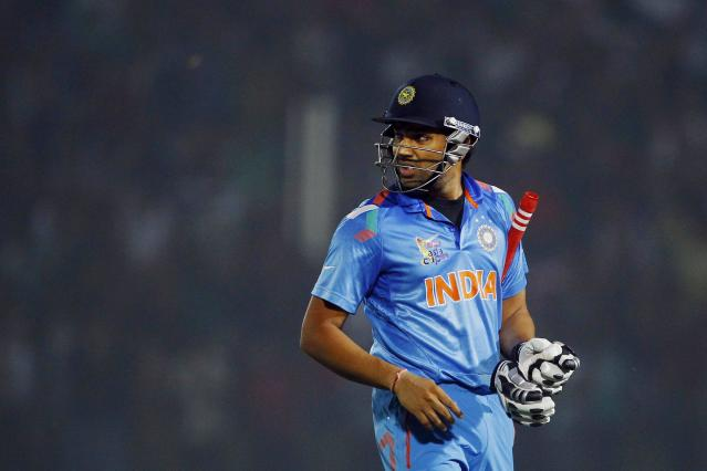 India's Rohit Sharma looks back as he walks back to the pavilion after his dismissal by Bangladesh's Ziaur Rahman during the Asia Cup one-day international cricket tournament between them in Fatullah, near Dhaka, Bangladesh, Wednesday, Feb. 26, 2014. (AP Photo/A.M. Ahad)