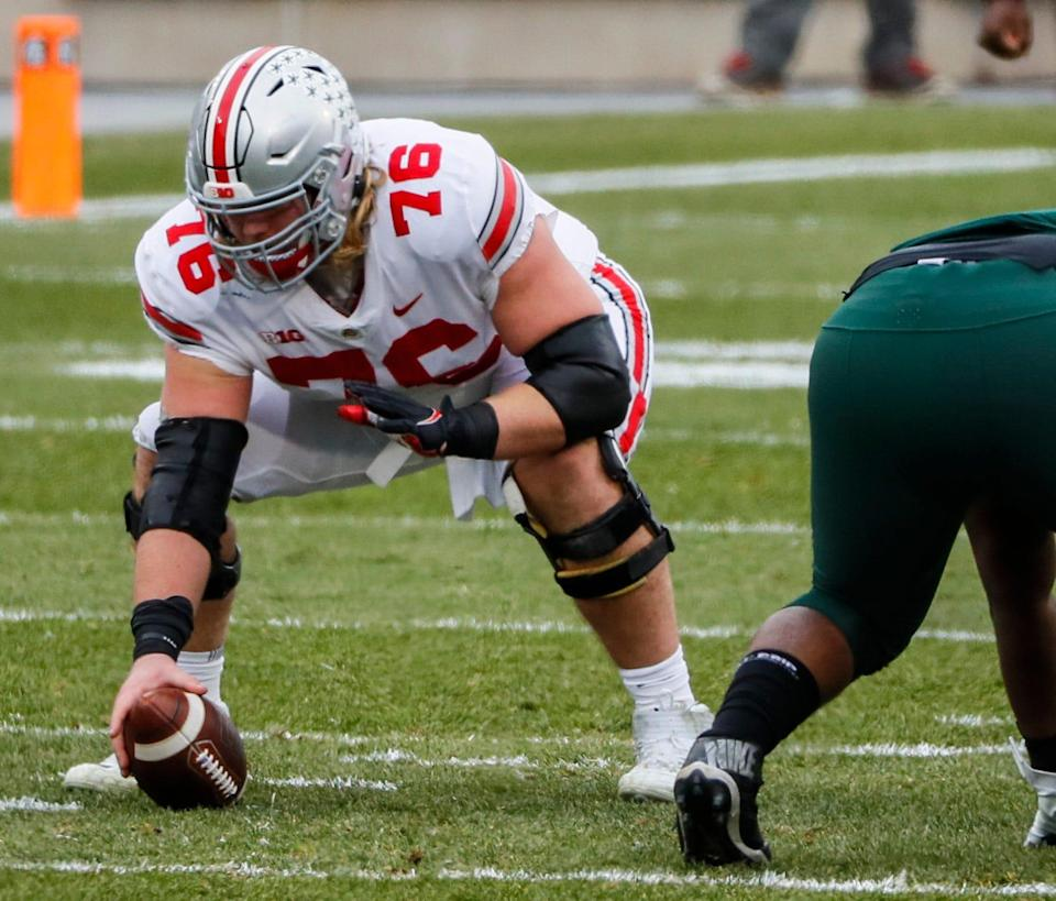 Ohio State Buckeyes offensive lineman Harry Miller (76) prepares to snap the ball during the first quarter of a NCAA Division I football game between the Michigan State Spartans and the Ohio State Buckeyes on Saturday, Dec. 5, 2020 at Spartan Stadium in East Lansing, Michigan.
