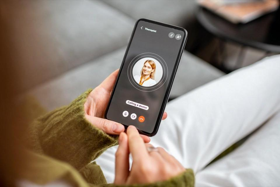 Woman making video call to a doctor using digital tablet, feeling bad at home. Concept of telemedicine and patient counseling online