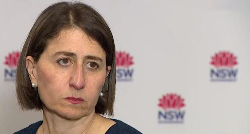 Premier Gladys Berejiklian, wearing pearl earrings, looks glum as she answers questions at Wednesday's press conference.