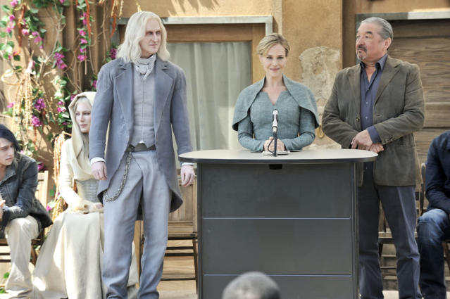 "Tony Curran as Datak Tarr, Julie Benz as Amanda Rosewater and Graham Greene as Rafe McCawley in the series premiere of ""Defiance."""