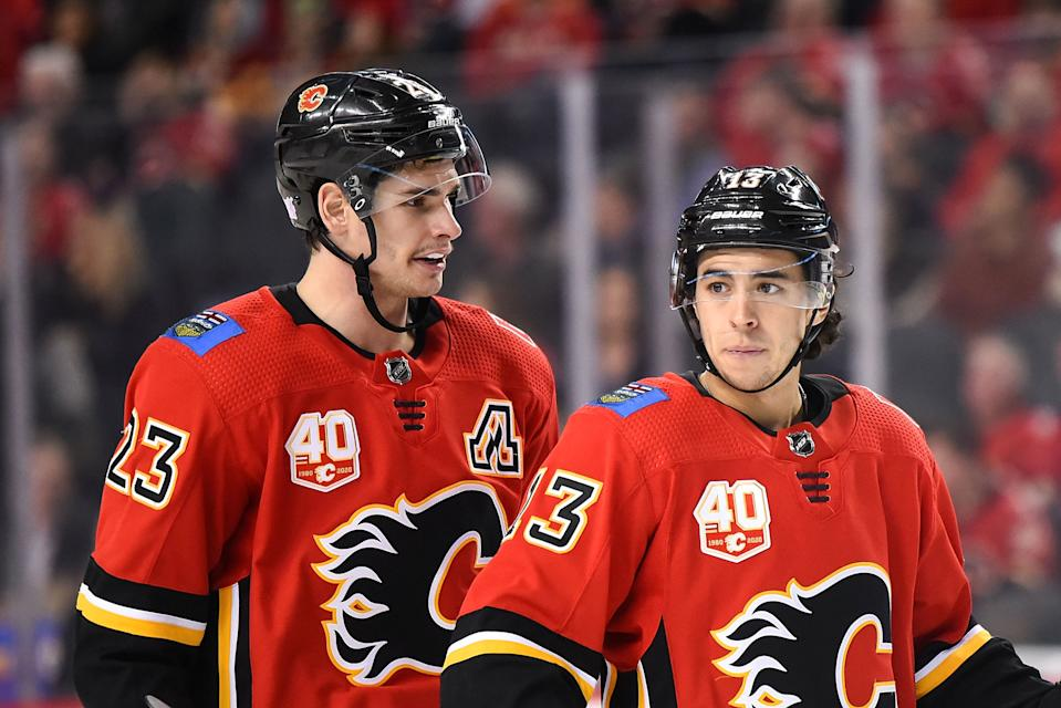 CALGARY, AB - NOVEMBER 13: Calgary Flames Center Sean Monahan (23) and Left Wing Johnny Gaudreau (13) talk before a whistle during the third period of an NHL game where the Calgary Flames hosted the Dallas Stars on November 13, 2019, at the Scotiabank Saddledome in Calgary, AB. (Photo by Brett Holmes/Icon Sportswire via Getty Images)