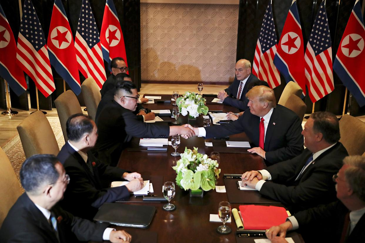 Trump and Kim shake hands again before their expanded bilateral meeting.