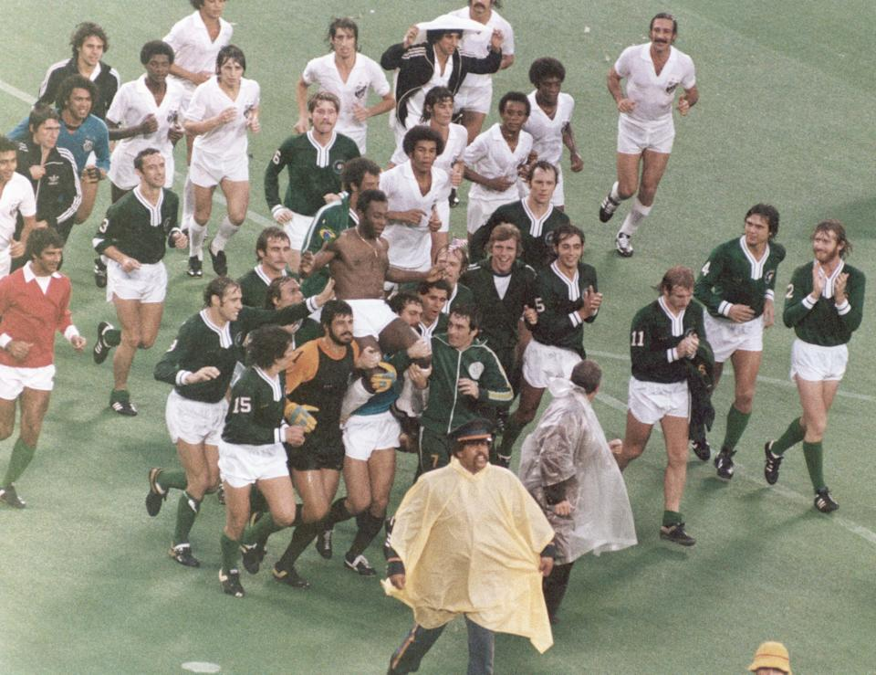 EAST RUTHERFORD, NJ - OCTOBER 1: Pele leaves the field following his final game. Pele played for his two club teams, New York Cosmos in the first half and Santos FC in the second half during the game played on October 1, 1977 in East Rutherford, New Jersey. (Photo by Robert Riger/Getty Images)