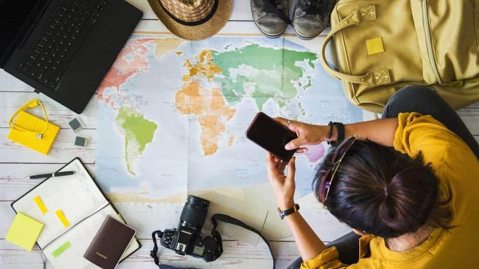 Vacation travel planning concept with map.