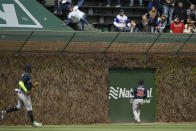 Atlanta Braves outfielders Guillermo Heredia, right, and Marcell Ozuna, left, watch Chicago Cubs' David Bote's three-run home run during the fifth inning of a baseball game Saturday, April 17, 2021, in Chicago. (AP Photo/Paul Beaty)