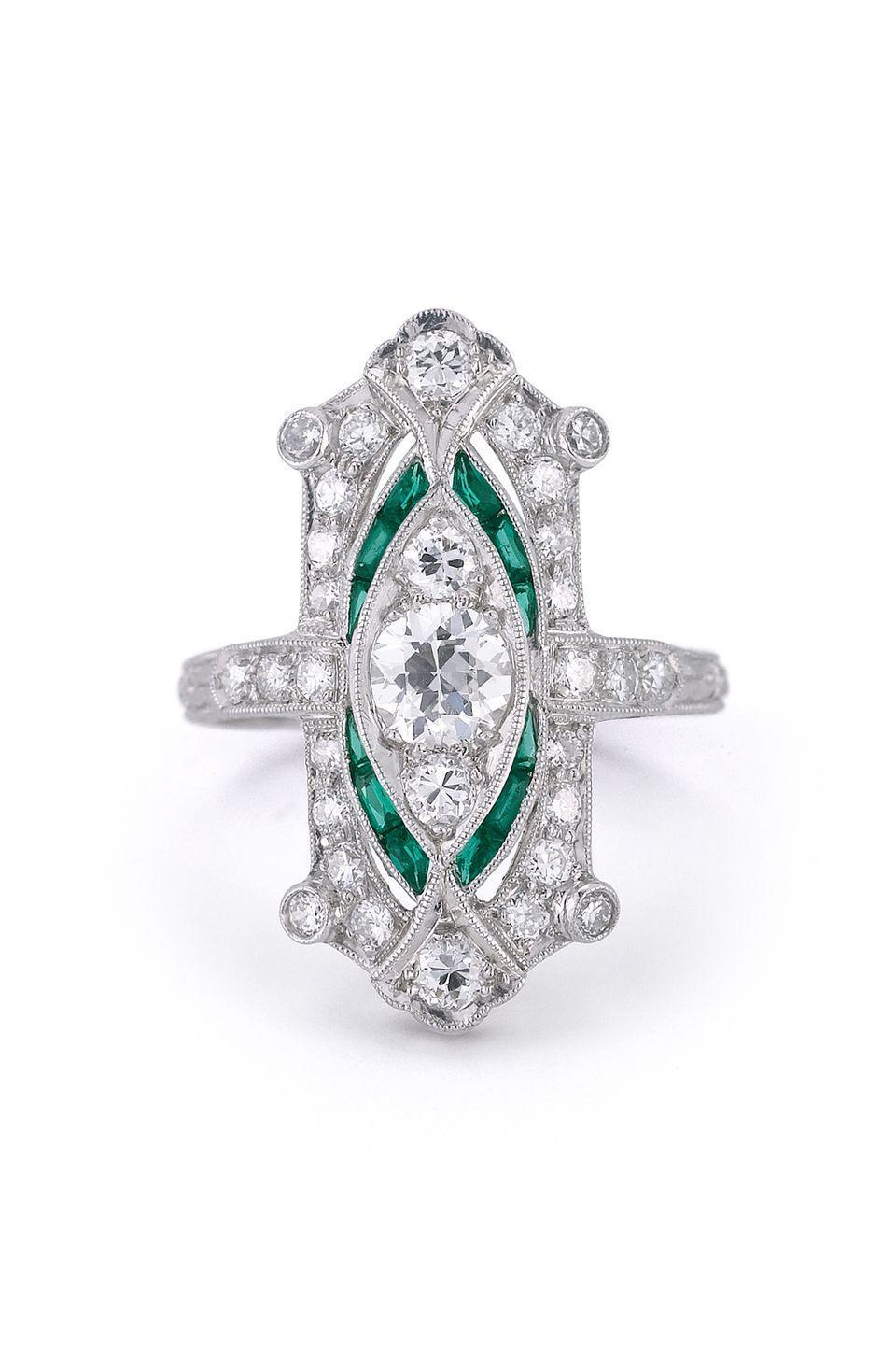 "<p><em><em><strong>McTeigue & McClelland</strong></em> Old European Cut Diamond and Natural Emerald Engagement Ring Circa 1905, price upon request, <a href=""http://www.mc2jewels.com/"" rel=""nofollow noopener"" target=""_blank"" data-ylk=""slk:mc2jewels.com"" class=""link rapid-noclick-resp"">mc2jewels.com</a></em></p><p><a class=""link rapid-noclick-resp"" href=""http://www.mc2jewels.com/"" rel=""nofollow noopener"" target=""_blank"" data-ylk=""slk:SHOP"">SHOP</a></p>"