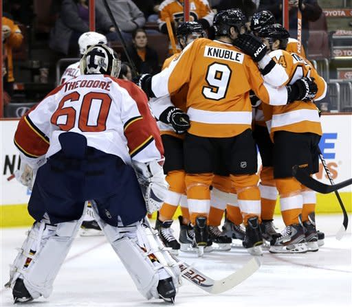 Philadelphia Flyers' Mike Knuble (9) and Kimmo Timonen (44), of Finland, celebrate with teammates after a goal by Philadelphia Flyers' Matt Read against Florida Panthers' Jose Theodore (60) during the second period of an NHL hockey game, Thursday, Feb. 7, 2013, in Philadelphia. (AP Photo/Matt Slocum)