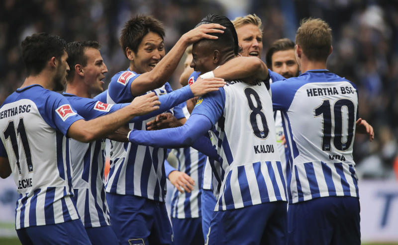 Hertha's Salomon Kalou, center, celebrates with teammates after his equalizing goal for the 2-2 during the German Bundesliga soccer match between Hertha BSC Berlin and Bayern Munich at the Olympic Stadium in Berlin, Germany, Sunday, Oct. 1, 2017. (Michael Kappeler/dpa via AP)