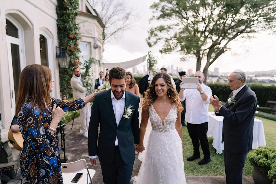 Keren and Jonno, who moved to Australia just three days before the border closed, pictured at their May lockdown wedding in Sydney, with ten in-person attendees and 400 guests on ZoomDavid Campbell