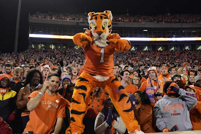 Clemson's mascot, the Tiger, and fans celebrate the team's 55-31 win over Georgia Tech during the second half of an NCAA college football game Thursday, Nov.14, 2013, at Memorial Stadium in Clemson, S.C.(AP Photo/ Richard Shiro)