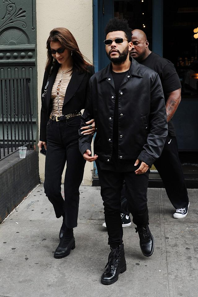 "Bella and The Weeknd (<a href=""https://www.teenvogue.com/story/bella-hadid-the-weeknd-have-reportedly-broken-up-again?mbid=synd_yahoo_rss"">who reportedly broke up again</a>), a fashionable couple if we ever knew one, hit the town in matching black fits. Even their bodyguard got in on the couple twinning! Both wore slender-rectangular specs, a la matrix, and clunky combat boots. They looked straight out of a 90s action film."