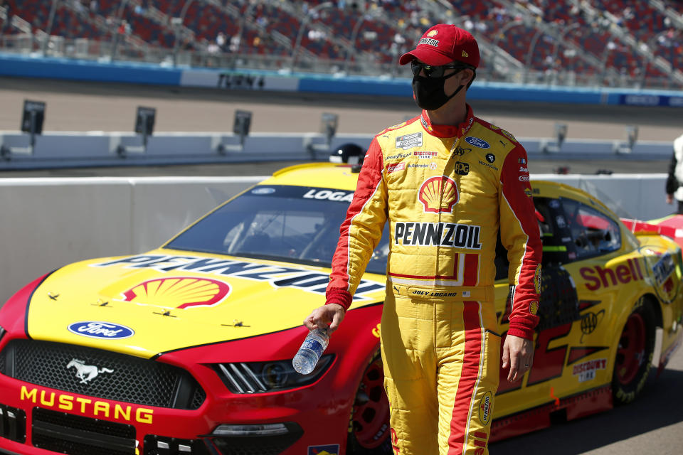 Joey Logano walks along pit road prior to a NASCAR Cup Series auto race at Phoenix Raceway, Sunday, March 14, 2021, in Avondale, Ariz. (AP Photo/Ralph Freso)