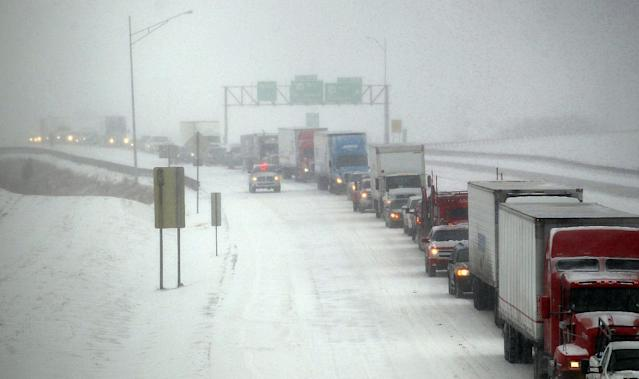 Traffic sits at a stand still on southbound Interstate 29, Tuesday, Feb. 4, 2014, in St. Joseph, Mo. An accident involving four vehicles caused the delays. (AP Photo/The St. Joseph News-Press, Jessica A. Stewart)