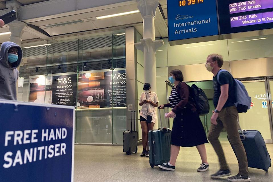 Travellers arriving off the Eurostar at St Pancras in London (PA)