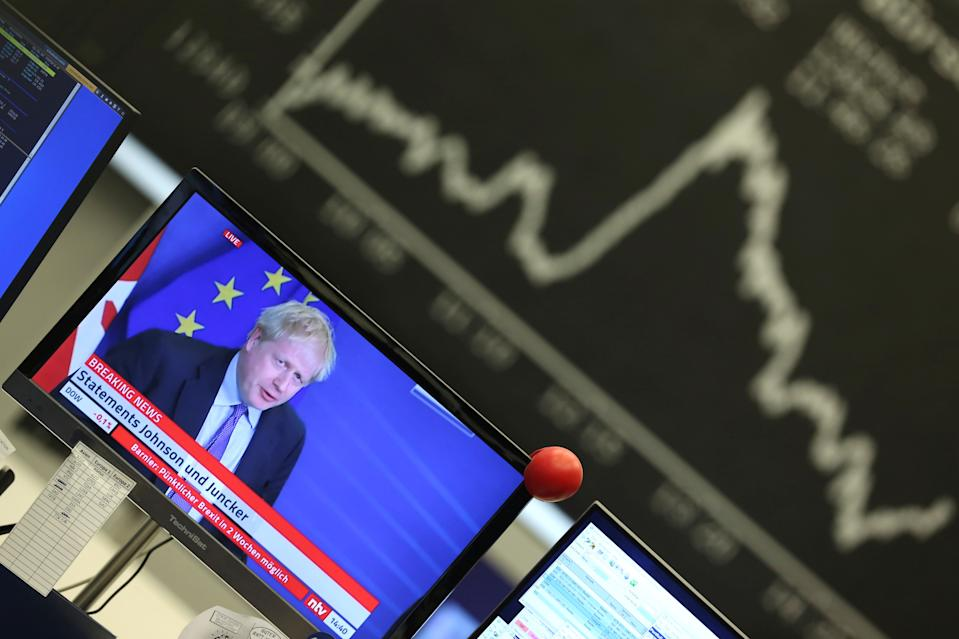 A television broadcast showing Britain's Prime Minister Boris Johnson during a news conference with European Commission President Jean-Claude Juncker after agreeing on the Brexit deal is pictured at Frankfurt's stock exchange in Frankfurt, Germany, October 17, 2019. REUTERS/Ralph Orlowski
