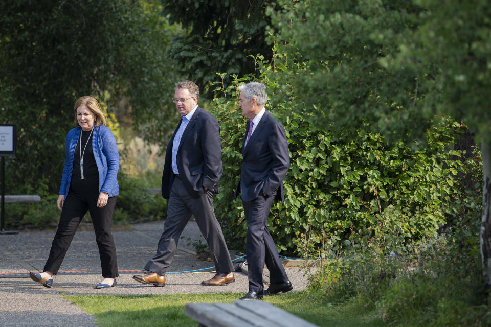 Esther George, left, President and CEO of the Federal Reserve Bank of Kansas City, John Williams, center, President and CEO of the Federal Reserve Bank of New York, and Jerome Powell, Chairman of the Board of Governors of the Federal Reserve System walk together after Powell's speech at the Jackson Hole Economic Policy Symposium on Friday, Aug. 24, 2018 in Jackson Hole, Wyo. Federal Reserve Chairman Jerome Powell signaled Friday that he expects the Fed to continue gradually raising interest rates if the U.S. economic expansion remains strong.  (AP Photo/Jonathan Crosby)