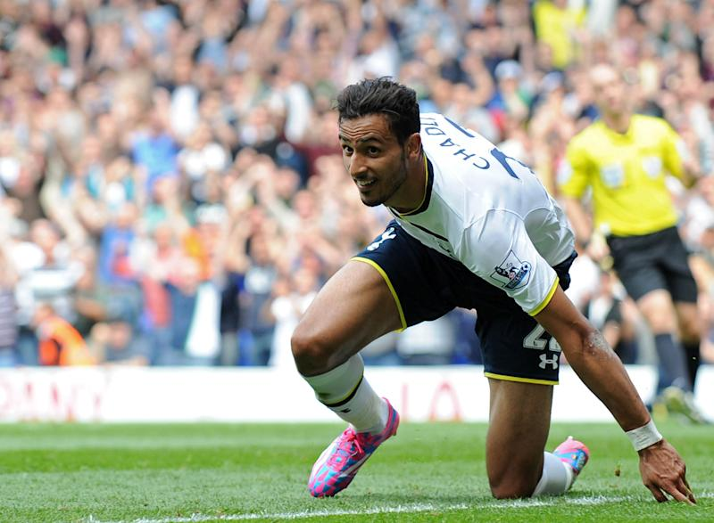 Tottenham Hotspur's Belgian midfielder Nacer Chadli celebrates scoring his second goal during the English Premier League football match between Tottenham Hotspur and Queens Park Rangers at White Hart Lane in north London on August 24, 2014 (AFP Photo/Olly Greenwood)