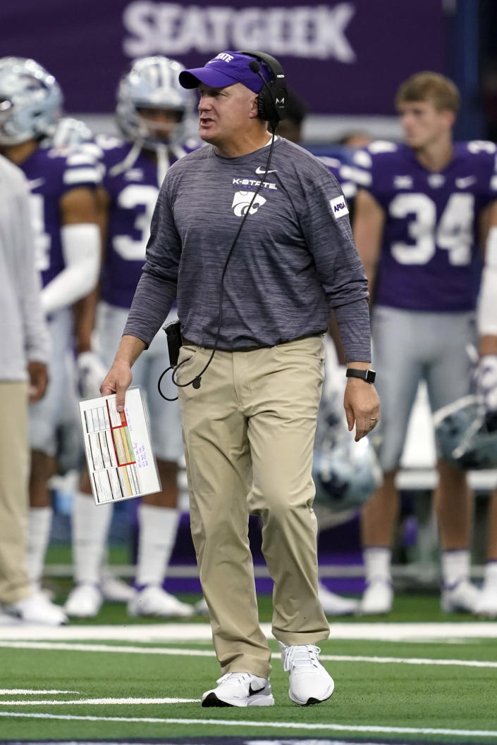 Kansas State head coach Chris Klieman instructs his team during time out in the first half of an NCAA college football game against Stanford in Arlington, Texas, Saturday, Sept. 4, 2021. (AP Photo/Tony Gutierrez)