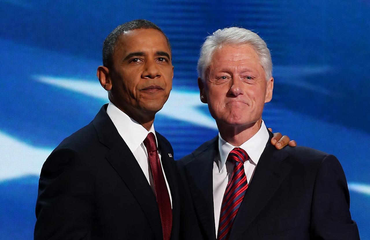 Former U.S. President Bill Clinton stands with Democratic presidential candidate, U.S. President Barack Obama (L) on stage during day two of the Democratic National Convention at Time Warner Cable Arena on September 5, 2012 in Charlotte, North Carolina. (Photo by Chip Somodevilla/Getty Images)