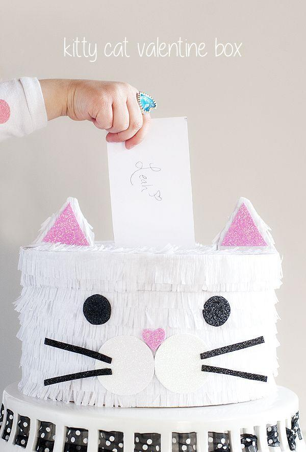 "<p>A few simple items put this pretty white cat together in no time, perfect for collecting lots of equally cute Valentines!</p><p><strong>Get the tutorial at <a href=""http://www.prettyplainjanes.com/2016/02/04/kitty-cat-valentine-box/"" rel=""nofollow noopener"" target=""_blank"" data-ylk=""slk:Pretty Plain Janes"" class=""link rapid-noclick-resp"">Pretty Plain Janes</a>.</strong></p><p><strong><strong><a class=""link rapid-noclick-resp"" href=""https://www.amazon.com/Tacklife-GGO20AC-Flexible-Overheating-Protection/dp/B075DDD9VN/?tag=syn-yahoo-20&ascsubtag=%5Bartid%7C10050.g.25844424%5Bsrc%7Cyahoo-us"" rel=""nofollow noopener"" target=""_blank"" data-ylk=""slk:SHOP HOT GLUE GUNS"">SHOP HOT GLUE GUNS</a></strong><br></strong></p>"