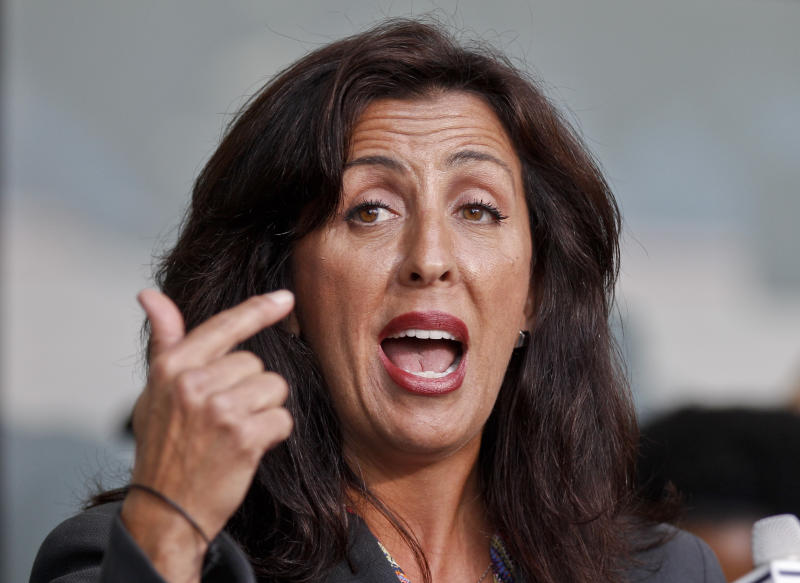 Lisa Damiani, an attorney and spokesperson for the parents of alleged Colorado mass murderer James Holmes, speaks at a news conference  Monday, July 23, 2012 in San Diego. Damiani says Holmes' mother had no idea he was believed to be the gunman who killed a dozen people in a Colorado theater until a reporter contacted her at her San Diego home. (AP Photo/Lenny Ignelzi)