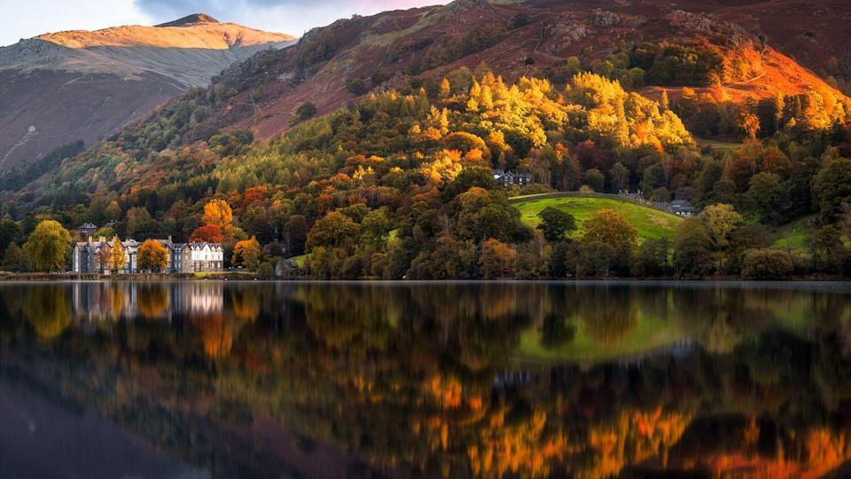 """<p>One of the most scenic spots in the UK, the Lake District is the perfect place to soak up the glorious colours of autumn. Located in the heart of Cumbria, this slice of paradise is famous for its beautiful lakes and mountainous fells. </p><p><a class=""""link rapid-noclick-resp"""" href=""""https://www.visitcumbria.com/"""" rel=""""nofollow noopener"""" target=""""_blank"""" data-ylk=""""slk:BOOK VISIT"""">BOOK VISIT</a> </p>"""