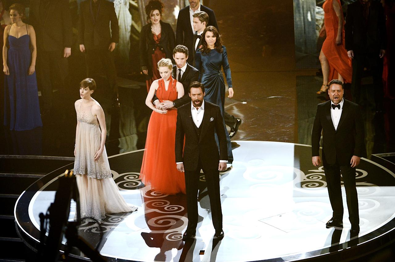 HOLLYWOOD, CA - FEBRUARY 24:  Actress Anne Hathaway, actor Hugh Jackman and actor Russell Crowe and members of the cast of Les Miserables perform onstage during the Oscars held at the Dolby Theatre on February 24, 2013 in Hollywood, California.  (Photo by Kevin Winter/Getty Images)