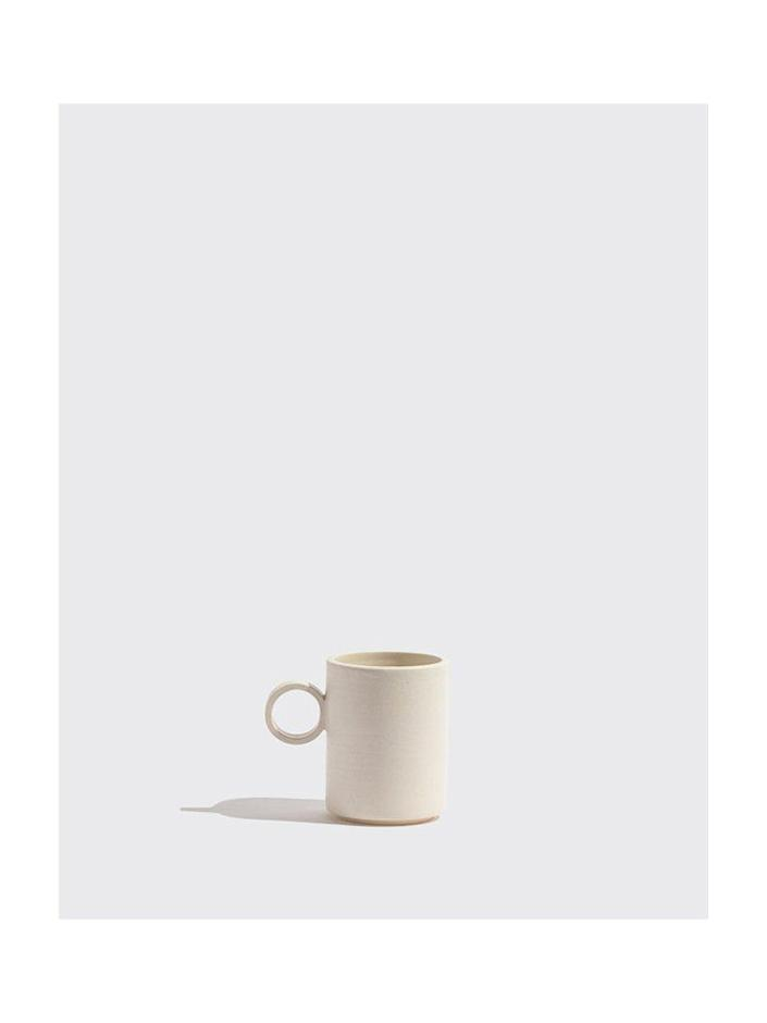 """Who doesn't love a new coffee mug? This subtle design goes well with any kitchen aesthetic, and that unexpected handle gives it a little pop of extra. $40, Yowie. <a href=""""https://www.shopyowie.com/products/white-mug"""" rel=""""nofollow noopener"""" target=""""_blank"""" data-ylk=""""slk:Get it now!"""" class=""""link rapid-noclick-resp"""">Get it now!</a>"""