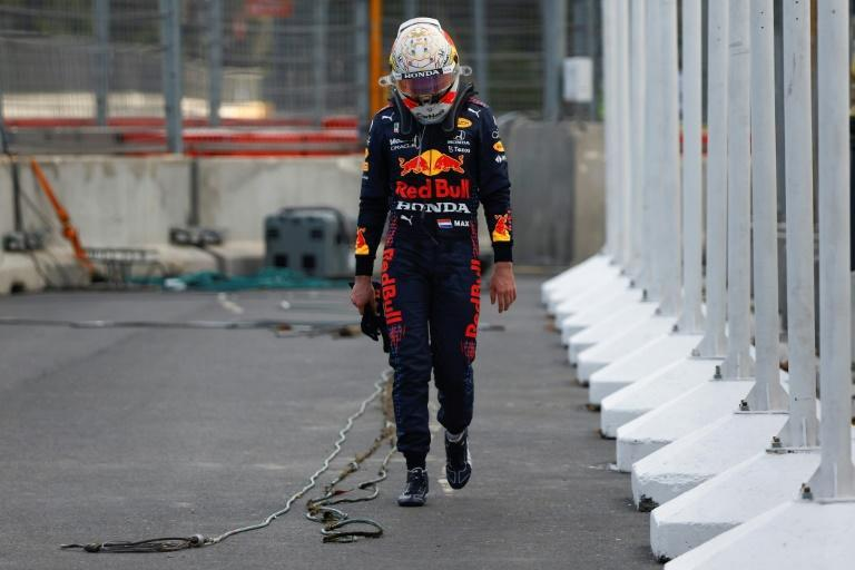 Verstappen trudges back to the pits