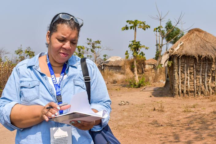 Investigations team editor Nichelle Smith takes notes in a village near Malanje, Angola on August 2, 2019. USA TODAY accompanied family historian Wanda Tucker to the African nation for the newspaper's 1619 Project.