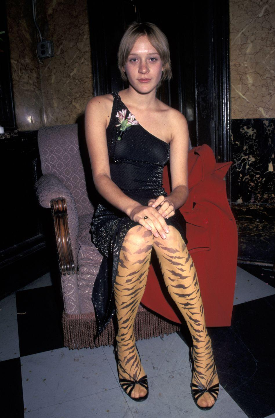 <p>Have you ever thought to pair tiger-stripe tights with a one-shoulder metallic dress? Well, that's what Chloë did at a New York City movie premiere, here. </p>