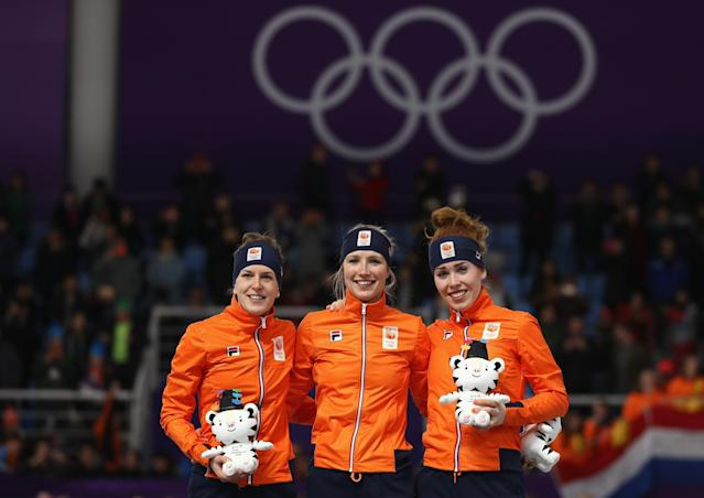 <p><span>The Netherlands pulled off an incredible sweep of the podium in the women's speed skating 3000m. Carlijn Achtereekte (center) won the gold medal while Netherlands teammates Ireen Wust (left) and Antoinette De Jong (right) won the silver and bronze medals respectively. </span> </p>