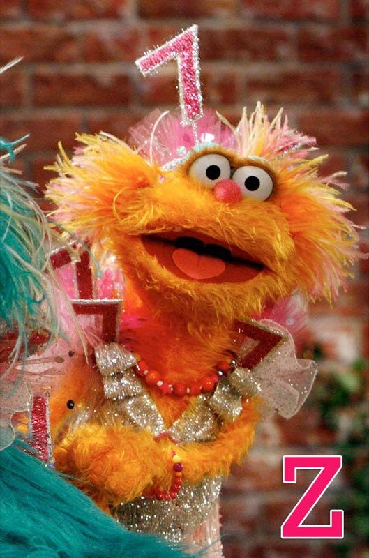 """Z is for Zoe: Zoe is an energetic, cute little girl monster with orange fur, barrettes in her hair, and a hoarse little laugh. She is always trying to learn and is one of the more inquisitive and boisterous residents on <a href=""""/sesame-street/show/33526"""">""""Sesame Street.""""</a> // More from <a href=""""http://www.zap2it.com/"""" rel=""""nofollow"""">Zap2it</a>: <a href=""""http://www.zap2it.com/news/custom/photogallery/celebrities/kiah-unsexy-list,0,13283.photogallery"""" rel=""""nofollow"""">A Hot Mess: 2009's Least Sexy Celebs</a>; <a href=""""http://www.zap2it.com/news/custom/photogallery/tv/zap-november-tv-sweeps-2009-pictures,0,3256356.photogallery"""" rel=""""nofollow"""">Set the DVR: November TV Sweeps Highlights</a>; <a href=""""http://www.zap2it.com/news/custom/photogallery/tv/zap-dwts-illness-injury-pics,0,3362400.photogallery"""" rel=""""nofollow"""">""""Dancing With the Stars"""": Illnesses and Injuries</a>"""